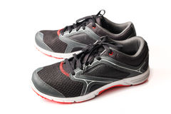New unbranded running shoe color black and red Royalty Free Stock Photos