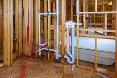 New under construction bathroom interior with interior framing of new house under construction. New under construction bathroom interior with interior framing of stock photos