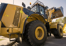 The new universal bulldozer with the lifted bucket Royalty Free Stock Images