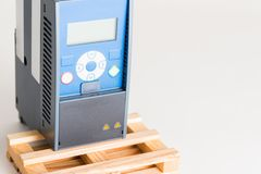 A new universal inverter for controlling the electric current and power for industrial on a gray white background. Royalty Free Stock Images