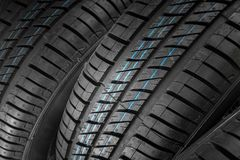 New and unused car tires against dark background Stock Image