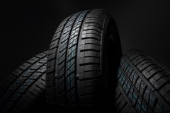 New and unused car tires against dark background Royalty Free Stock Photography