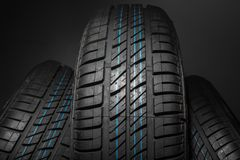 New and unused car tires against dark background Stock Images