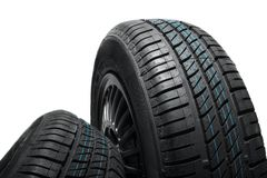 New and unused car tires against isolated background Stock Photos