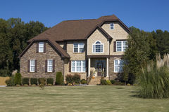 New upscale suburban house. With a large front yard Stock Images