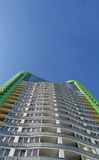New urban high building, green color, blue sky Royalty Free Stock Images