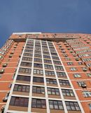 new urban high building, red brown brick, windows Royalty Free Stock Images
