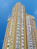 new urban high building, yellow brick, blue sky Stock Photography