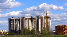 Urban housing estate. New urban housing estate of multi-storey houses built by construction companies for people stock footage