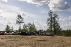 New Urengoy, YaNAO, North of Russia. June 22, 2014. Weekend. Cars are wainting when theirs owners are resting on the nature. Royalty Free Stock Photo