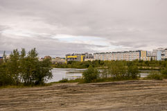 New Urengoy, YaNAO, North of Russia. September 1, 2013. Lake named Nameless between modern buildings Stock Images