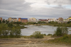 New Urengoy, YaNAO, North of Russia. September 1, 2013. Lake named Nameless between modern buildings Royalty Free Stock Photography