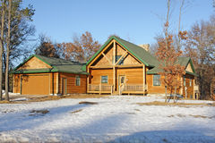 New vacation home in winter. Brand new vacation house in the countryside Stock Image