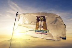 New Valley Governorate of Egypt flag textile cloth fabric waving on the top sunrise mist fog. Beautiful stock photos