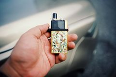 """New Vape pod system for quitting smoking habit alternative on hands. POD or """"ultra-portable systems"""" are essentially the middle-ground between your stock photo"""