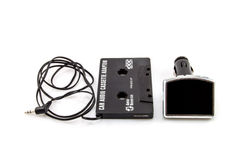 New versus old. Audio Cassette adapter and car FM transmitter royalty free stock photo