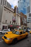 New Victory Theater in Manhattan, NYC. New Victory Theater and yellow cabs  in 42th street, Manhattan, NYC, USA Royalty Free Stock Photos