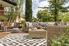 New villa patio idea. New design villa patio with comfortable rattan furniture and pattern carpet stock photography