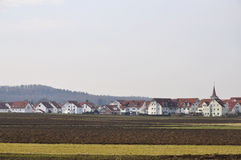 New village in baden countryside. Landscape with new houses forming a small village in baden, shot in winter light Royalty Free Stock Photography