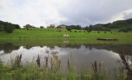 New village near pond in the Altai. Royalty Free Stock Photo