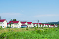 New village of similar houses in  summer sunny day. Russia Stock Photo