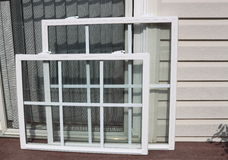 Vinyl Windows. New Windows ready to install, saving energy with double glasses to meet energy efficiency Stock Photography
