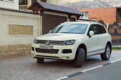 New Volkswagen Tuareg parked near house in street of the Sochi city. Royalty Free Stock Photography