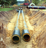 New water pipes mounting in a ground on a cloudy day Royalty Free Stock Images