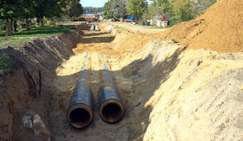 New water pipes mounting in a ground Royalty Free Stock Photo