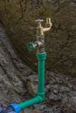 New Water Supply - Hole in the ground With Pipe and water valve Royalty Free Stock Photography