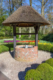 New water well with bucket in park Royalty Free Stock Images