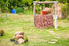 New water well with metal bucket in park Royalty Free Stock Photo