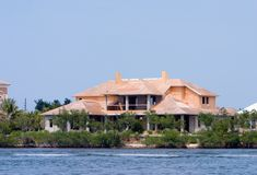New waterfront construction. New waterfront house under construction Royalty Free Stock Image