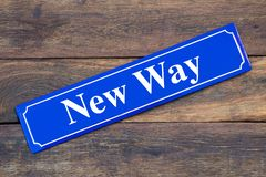 New Way street sign on wooden background. As symbol royalty free stock image