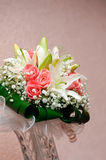 New wedding bouquet with rose and lily. Standing in vase Royalty Free Stock Photography
