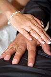 New wedding rings. Married couple holding hands together with wedding rings Royalty Free Stock Images