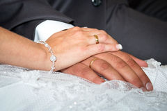 New wedding rings. Married couple holding hands together with wedding rings Stock Image