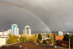 New Westminster, Canada - Circa 2017: A Large Rainbow over the c. New Westminster, Canada - Circa 2017: Large Rainbow over the city royalty free stock photo