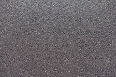 New wet asphalt road surface from above. New wet black asphalt road surface from above Royalty Free Stock Photos