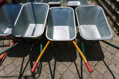 New wheelbarrows piled in row Royalty Free Stock Images