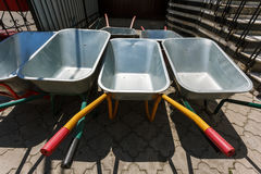 New wheelbarrows piled in row Royalty Free Stock Photography