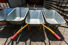 New wheelbarrows piled in row Royalty Free Stock Photography