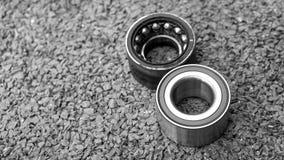 New wheels car bearing and old wheels car bearing on asphalt flo Stock Photos