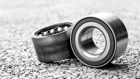 New wheels car bearing and old wheels car bearing on asphalt flo Stock Images