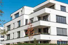 New white apartment house in front of a blue sky. Seen in Berlin, Germany Royalty Free Stock Image
