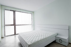 New white bedroom with double bed Stock Photography