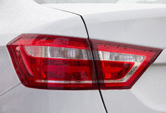 New white car tail light. Close up of new white car tail light Stock Photos