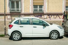 New white Citroen C3 small compact car parked on the street in the city. stock photos