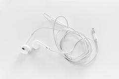 New white earphones Royalty Free Stock Image