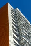 New white orange multi-storey residential building. With some windows Royalty Free Stock Photography